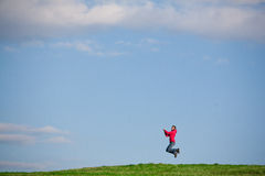Joyful young woman jumping Royalty Free Stock Photo