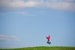 Joyful young woman jumping Royalty Free Stock Photo