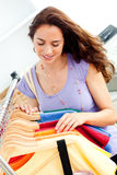 Joyful young woman looking for clothes Royalty Free Stock Photos