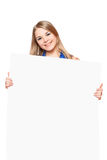 Joyful young woman posing with white board Royalty Free Stock Photos