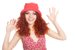 Joyful young woman in a red hat Stock Photography