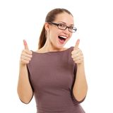 Joyful young woman showing OK sign Stock Photos