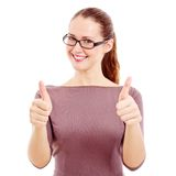 Joyful young woman showing thumbs up Stock Image