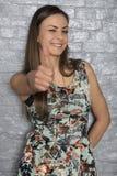 Joyful young woman, thumbs up. Portrait Stock Images