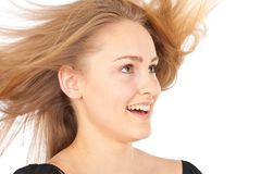 Joyful young woman with waving hair Stock Photography