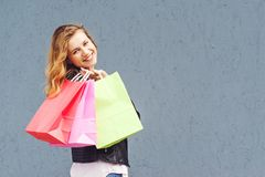 Joyfull casual woman holding shopping bags. Stock Images