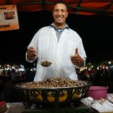 Snail soup seller. Joyfull face of a snail soup seller in Jemaa el-Fnaa square Royalty Free Stock Photos