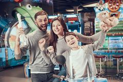 Joyfull family in entertaiment center. Family rest, leisure. Spending holiday together with family. Entertainment center, mall, amusement park Stock Photography