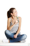 Joyfull female teen sitting on a table. Stock Images
