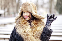 Joyfull russian woman in fur hat and coat Royalty Free Stock Photography