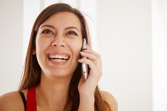 Joyfull Young Girl Talking on the Phone. Royalty Free Stock Photos