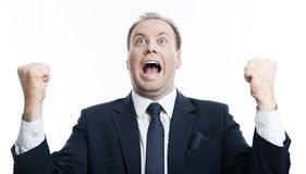 Joyfully exclaiming man businessman Stock Photo