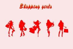 joying购物的五个女孩 免版税图库摄影
