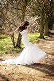 Joyous Bride. A joyous bride on a wooded path outside stock photography