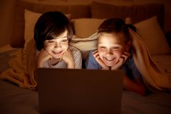 Two happy youngsters watching movie