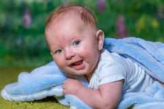 Joyous child laughs. Close-up portrait Stock Image
