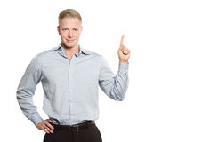 Smiling businessman pointing finger at space for text. Stock Image