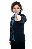 Joyous corporate woman pointing you out Royalty Free Stock Images
