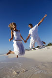 Joyous couple on beach Stock Image