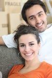 Joyous couple moving house Stock Photos