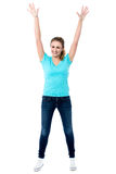 Joyous female raising arms in excitement Royalty Free Stock Photography