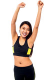 Joyous female raising arms in excitement Stock Photos