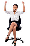Joyous female raising arms in excitement Stock Images