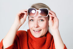 Joyous girl enjoying winter sun with big white sunglasses Royalty Free Stock Images