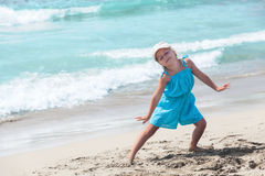 Joyous girl posing on sandy beach Stock Photos