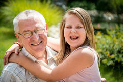 Joyous life - grandfather with grandchild Stock Image