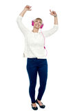 Joyous middle aged woman dancing to the beat Royalty Free Stock Image