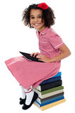 Joyous pretty school kid with tablet pc Stock Photo
