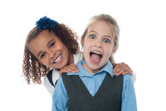 Joyous school girls playing royalty free stock photo