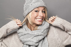Joyous sexy 20s winter girl expressing joy with fake smile Royalty Free Stock Photography