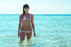 Joyous slim woman in bikini standing in water Royalty Free Stock Photos