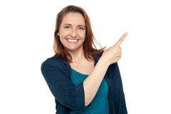 Joyous smart woman pointing away Stock Photography