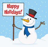 Joyous snowman holding a blank sign on a hill Royalty Free Stock Image