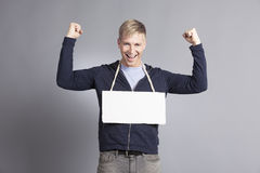 Joyous successful man presenting empty signboard. Royalty Free Stock Image