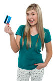 Joyous teenager displaying credit card Stock Photos