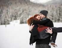 Joyous woman in arms of her bearded boyfriend Stock Images