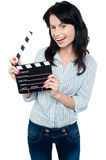 Joyous woman with clapperboard Stock Images