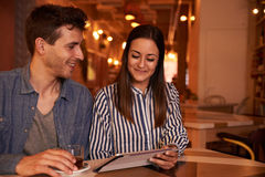 Joyously happy young couple in restaurant Stock Photo