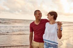 Joyously laughing couple on the beach Stock Photo