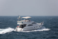Joyride with a luxury motor yacht Stock Photography
