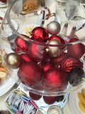 The joys of the holidays. Holiday ornaments love celebrate cheers bowl Royalty Free Stock Images