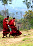Joys of life. Young monks enjoy a game of football Royalty Free Stock Photography