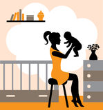 Joys of motherhood. Young woman sitting on a stool and raises the baby in his arms Stock Photos