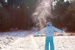 Joys of the winter season. Shot of a little girl throwing a handful of snow up into the air on a sunny winter's day outdoors Royalty Free Stock Images