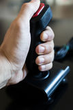 Joystick arcade game for computer and console from 80& x27;s. Black c. Hand holding a joystick for arcade game. Retro vintage controller Royalty Free Stock Image