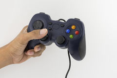 Joystick for video games. In the laft hand Royalty Free Stock Photos